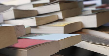 tomes: Abstract image of books at the second hand bookshop. Stock Photo