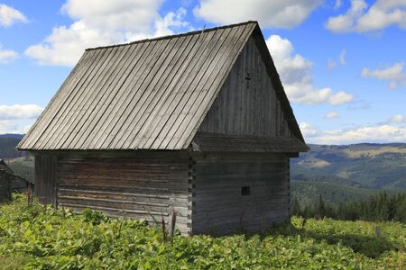 exclusively: Traditional old wooden house which can be found in Apuseni Mountains,Transylvania,Romania.It is built exclusively of wood without any pieces of iron.