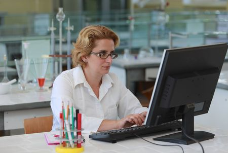 Female researcher working on a computer in a laboratory. Stock Photo - 5593844