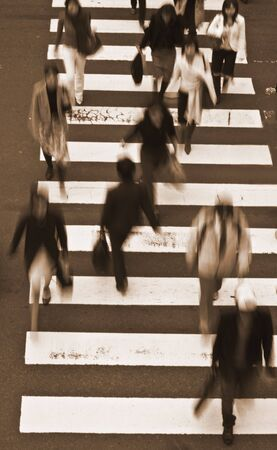 haste: Group of people crossing the street-upper view,sepia tones Stock Photo