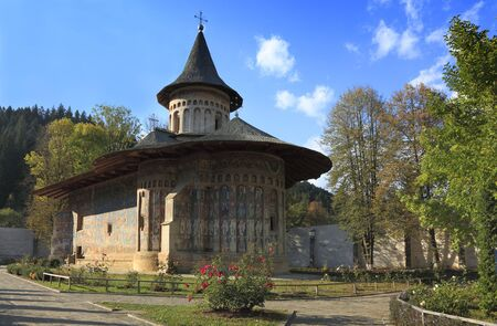 Image of Voronet Monastery,Moldavia,Romania.The frescoes at Voronet feature an intense shade of blue known in Romania as Voronet blue.It was built in 1488 by Stephen the Great and is one of the most famous painted monasteries from Moldavia. photo