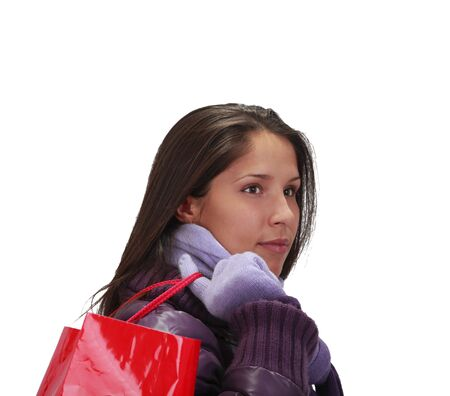 Portrait of a young woman with a shopping bag over her shoulder. photo