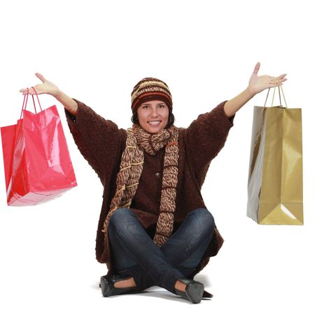 Happy woman with shopping bags isolated against a white background Stock Photo - 6100693