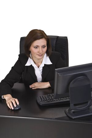 webdesigner: Young businesswoman browsing the internet at her desk. Stock Photo
