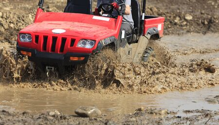 Detail of an ATV during the muddy race. Stock Photo - 6339745