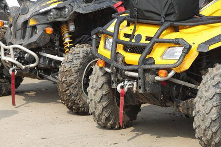 Low angle veiw of the front part of a row of ATVs. photo