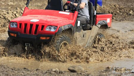 Detail of an ATV during the muddy race. photo