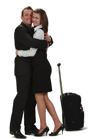 A young man and a woman hugging near a roller suitcase,isolated against a white background. Stock Photo - 6840939