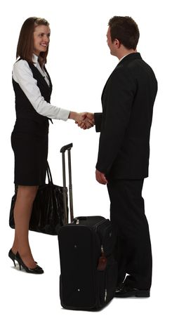Image of a young businesswoman and a young businessman shaking hands near a roller suitcase, isolated against a white background. photo