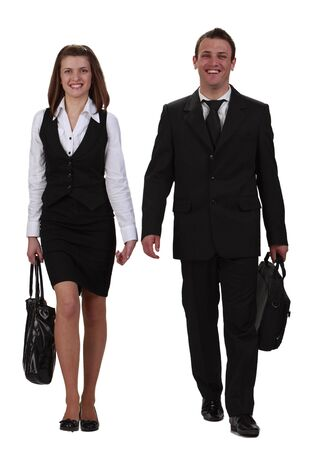 skirt suit: Young happy couple walking together towards the camera,isolated against a white background.