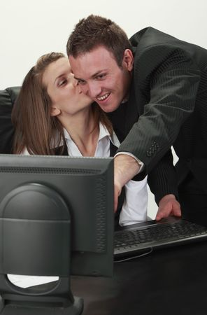 Young office colleagues having fun in front of an office computer. Stock Photo - 6840964