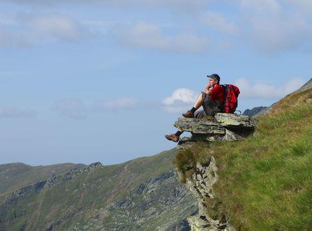 Man scrutinizing the horizon in mountains. photo