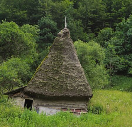 A very traditional house, specific for Motilor Country in Transylvania,Romania. These houses are made exclusively of wood without any piece of iron. Now such buildings are used in wild areas as stalls or barns for animals. Stock Photo - 7080058