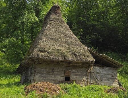 exclusively: A very traditional house, specific for Motilor Country in Transylvania,Romania. These houses are made exclusively of wood without any piece of iron. Now such buildings are used in wild areas as stalls or barns for animals.