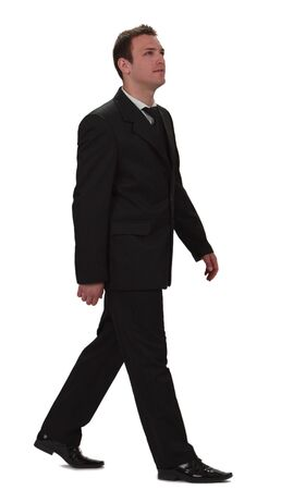 person walking: Image of a young businessman walking, isolated against a white background. Stock Photo