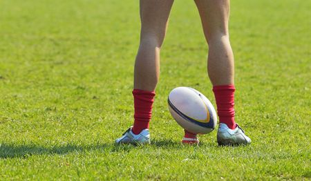 A rugby player's legs preparing to kick a rugby ball. Stock Photo - 7631737