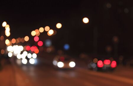 blur: Defocused night scene of traffic lights and cars.