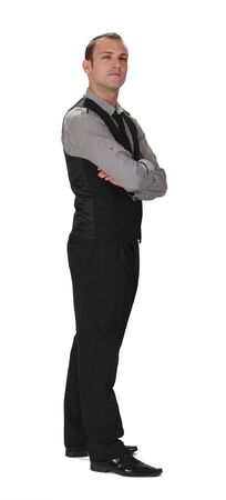 entrepeneur: Young confident businessman standing up against a white background. Stock Photo