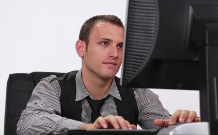 businessman working at his computer: Image of a young businessman working on his computer.