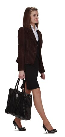 woman walking: Image of a young businesswoman with bag walking, isolated against a white background.