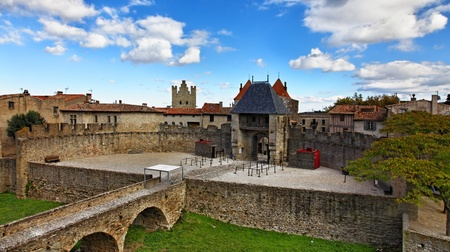 fortified: Image of the Entrance in The Carcassonne as it is seen from the castle.Carcassonne is a very famous fortified medieval town located in the Languedoc-Roussillon (Aude department) region in the South of France. Stock Photo