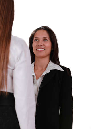 Two young women discussing isolated against a white background Stock Photo - 8736478