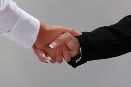 Close up image of women shaking hands. photo