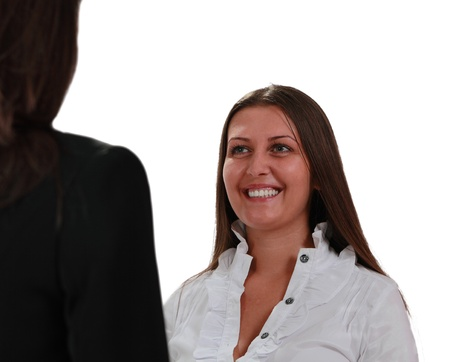 Two young women discussing isolated against a white background Stock Photo - 8884649