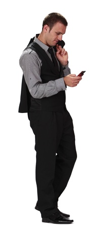 Young businessman chacking his mobile phone,isolated against a white background. Stock Photo