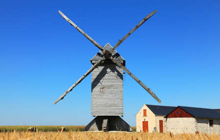 Traditional wooden windmill in the Eure&Loir region of France.This windmill is  photo