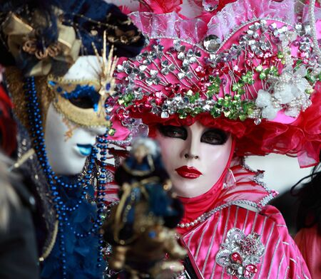 Venice,Italy,February 26th 2011:Close up image of colourful masks during the Canival of Venice.Selective focus on the eyes of the red mask.The Carnival of Venice (