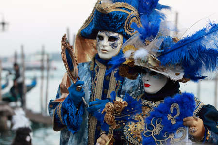carnevale: Venice,Italy,February 26th 2011:Two Venetian masks posing near the pagodas port in San Marco Square in Venice during the carnival days.Selective focus on the first mask from left.The Carnival of Venice (Carnevale di Venezia) is an annual festival, held Editorial