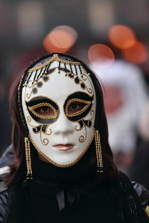 Venice,Italy,February 26th 2011:Portrait of a person wearing a characteristic masks during the Carnival of Venice nights.The Carnival of Venice ( Stock Photo - 9144300