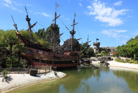 Paris,France,July 11th 2010: Image of the ship of pirates located near the beach of pirates in Adventureland in Disneyland Paris.In the distance you can see a Pirates of the Carabbean theme park.