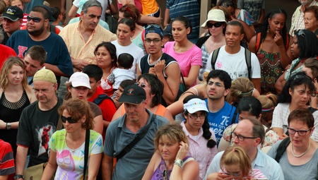 Paris,France,June 11th 2010: Crowd of tourist waiting for embarkation on a touristic ship.