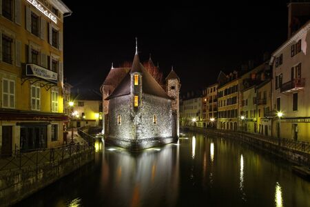 Annecy,France,February 23rd 2011:Night image of the Palace of the Isle in Annecy, France.This palace was built in the centre of the Thiou canal and it has a shape of a ship.The building had a rich history.It was used as residence for a local lord, adminis