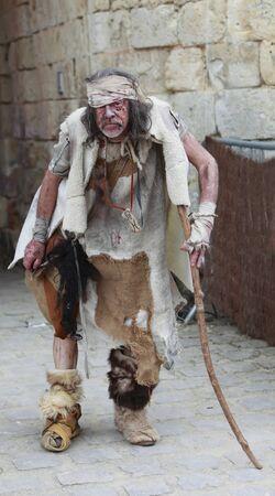dirty old man: Leprous man during Week-end de Lascension-Grand Fête médiévale in Nogent de Rotrou, France, 15-16.05.2010.