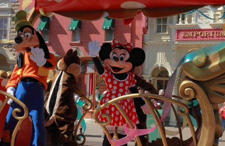 Paris,France,July,11th 2010: Goofy and Minnie Mouse waving to the fans while passing by them in the All Stars Express at Disneyland, Paris.   Stock Photo - 9308702