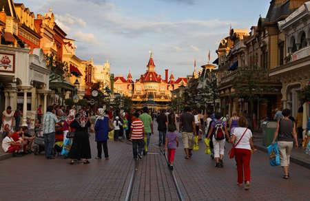 disneyland: Paris,France,July 11th 2010: Image of the main street in Disneyland Paris at the dusk.
