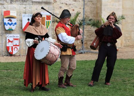 castello medievale: Nogent le Rotrou,France,May,16th,2010:A band of three medieval musicians performing in the yard of the castle during the Week-end de Lascension-Grand Fete medievale. This was a historical reenactment festival around the Saint Jean Castle.