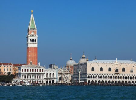 campanille: View of buildings from St. Mark (San Marco) square in Venice seen from the Venetian Lagoon. In the first plane you can see at the left The St.Marks Campanille and at the right the Doges Palace.