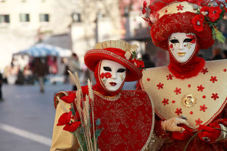 impart: Venice,Italy,February 26th 2011: Image of two actors wearing specific costumes and masks during the The Carnival of Venice days.The Carnival of Venice (