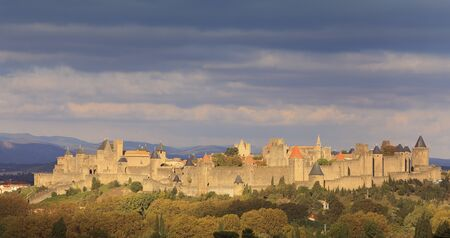 fortified: Dusk image of the famous fortified town of Carcassonne, France.