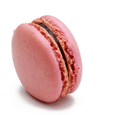 Image of a traditional French pink macaron against a white background. photo