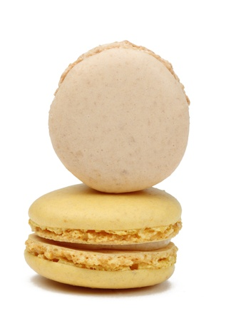 Two French macarons isolated against a white background.Useful copyspace for your text on the vertical macaron. photo