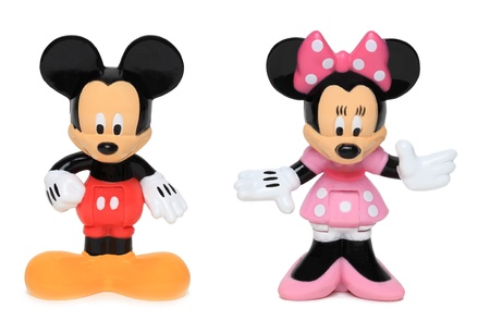 Chartres, France, June 19th, 2011: Studio shot of Disney cartoon characters Mickey Mouse and Minnie Mouse against a white background.