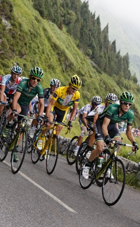 Col dAbisque,France,July 15th 2011:Image of a group of cyclists including The Yellow Jersey (Thomas Voeckler-Team Europecar) climbing the category H mountain pass Abisque in the 13th stage of the 2011 edition of Le Tour de France, the biggest cycling r