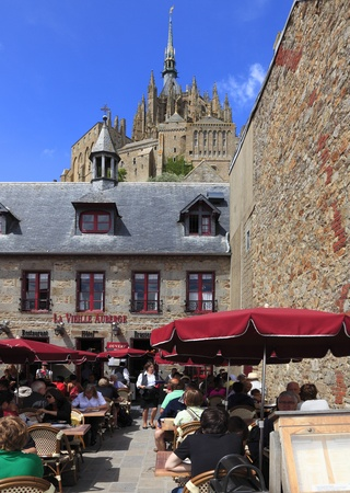 michel: Mont Saint Michel,France, July 16th 2010:Image of a terrace of a restaurant full of clients at the lunch time at The Mount Saint Michel Monastery in Base Normandy,France.