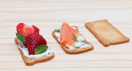Image of tasty snacks on a wooden surface. Stock Photo - 10431204