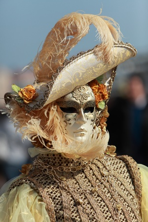 Portrait of a Venetian mask and costume during the Carnival of Venice days.
